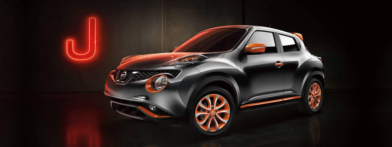 2017 Nissan Juke in black next to neon sign