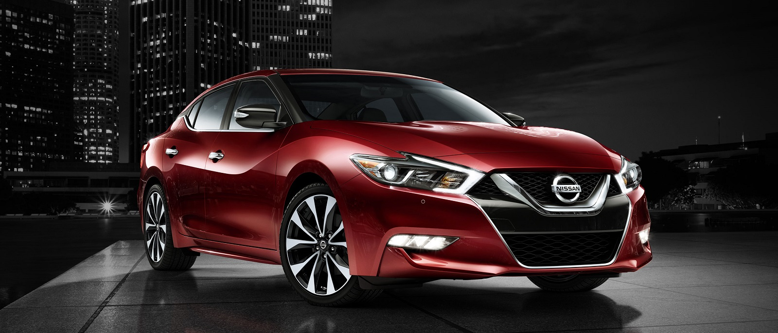 2016-nissan-maxima-coulis-red-side-view-night-skyline