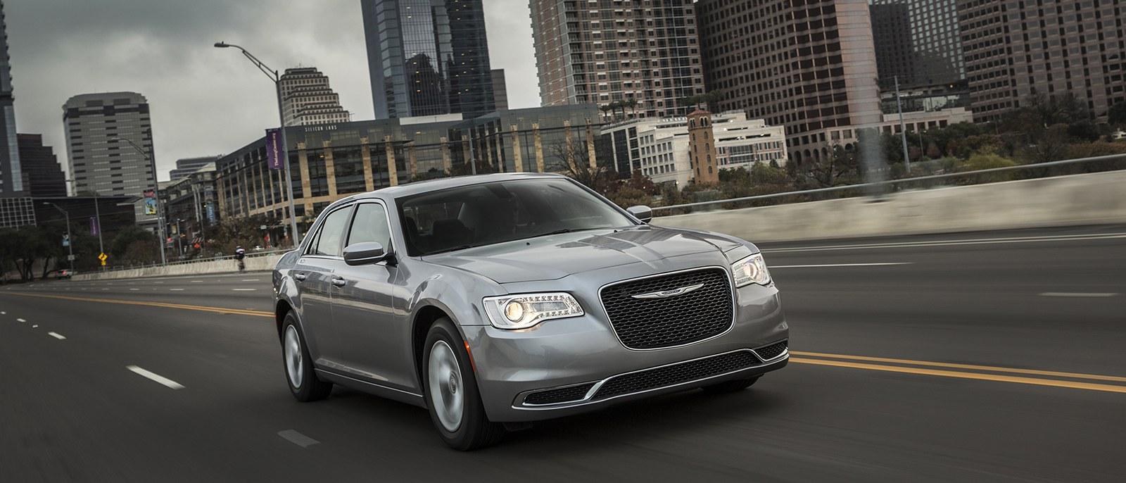 Silver 2016 Chrysler 300 Driving