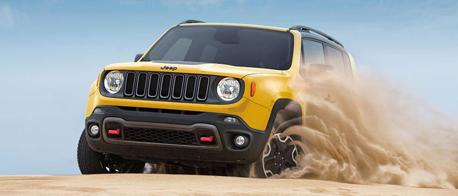 2016 Jeep Renegade driving through sand dunes