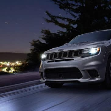 2018 Jeep Grand Cherokee on highway at night