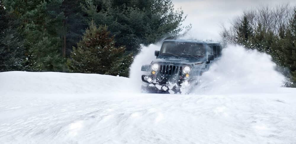 2018 Jeep Wrangler JK plows through snow
