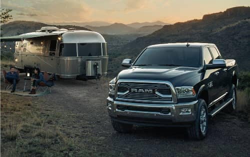 2018 Ram 2500 parked next to motor home trailer