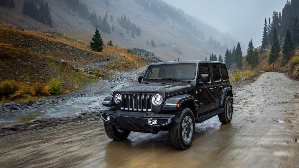 2019 Jeep Wrangler on a muddy road