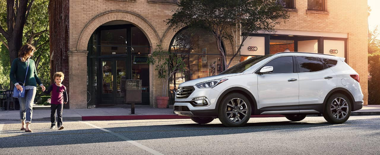 2018 Hyundai Santa Fe Sport at crosswalk where mom walks by with child