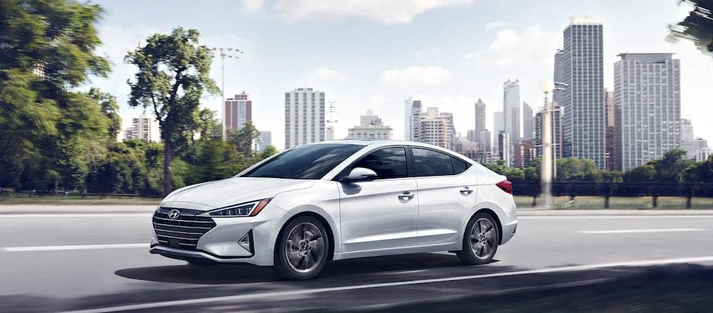 A 2020 Hyundai Elantra on a street with a city skyline in the background