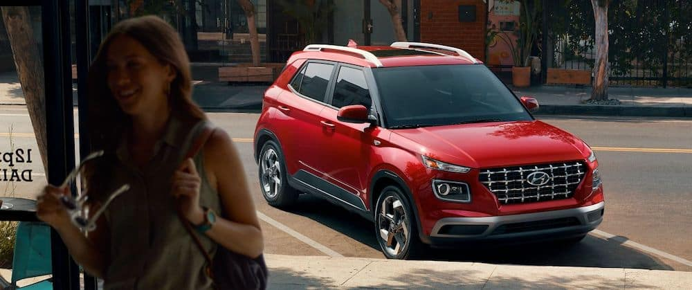 A 2020 Hyundai Venue in Scarlet Red parked on a city street