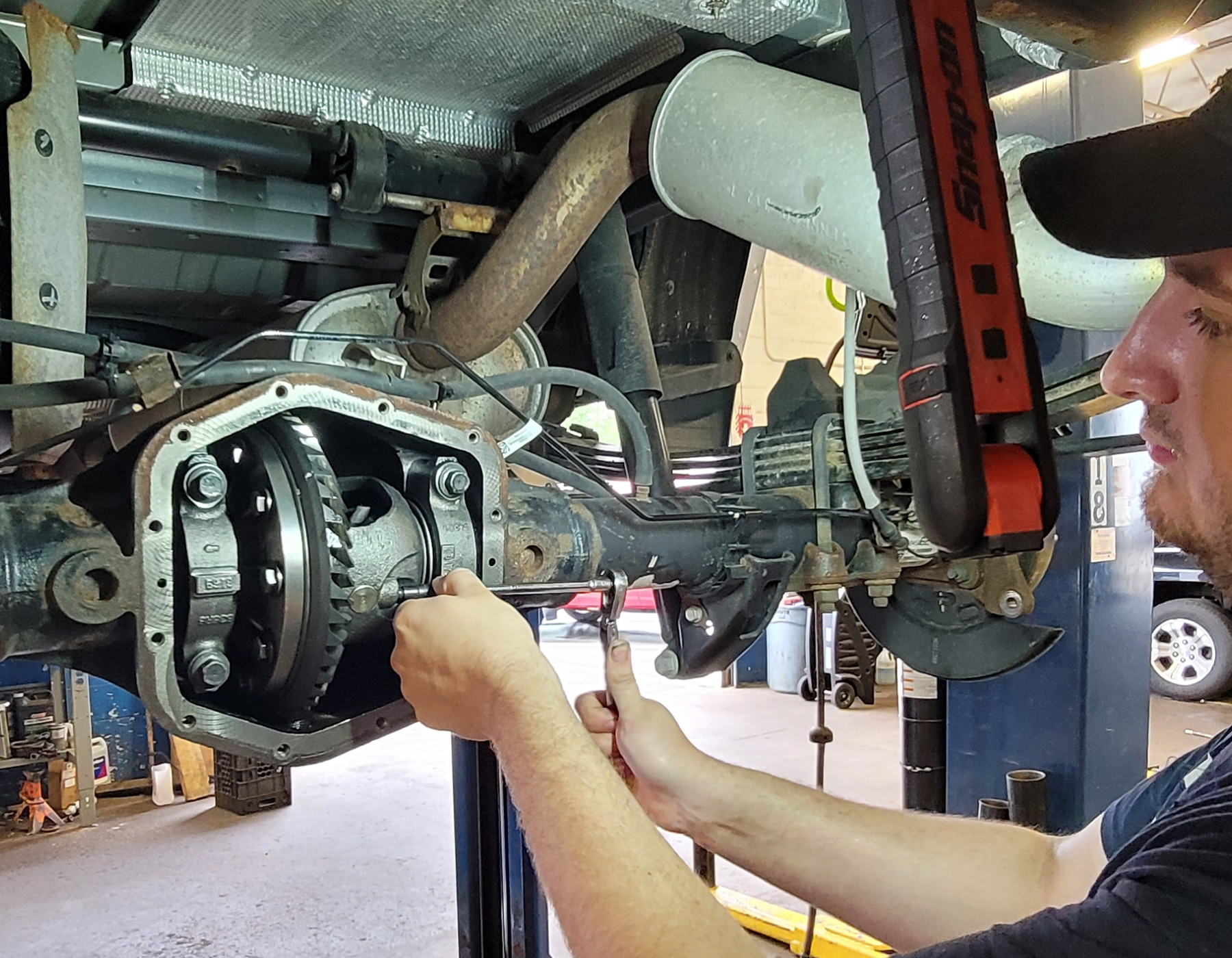 A service person helping a customer and an oil change.