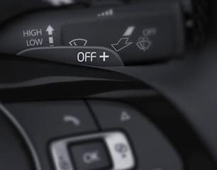 Leather-wrapped, multi-function steering wheel with paddle shifters