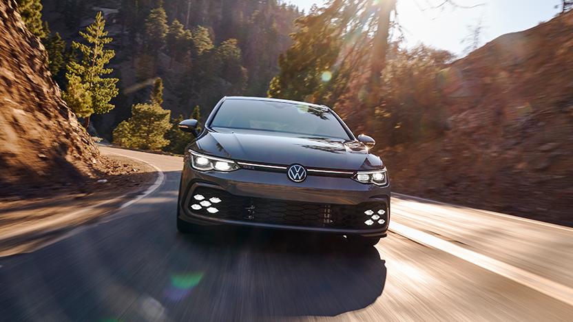 2022 Volkswagen Golf GTI on mountain side road.