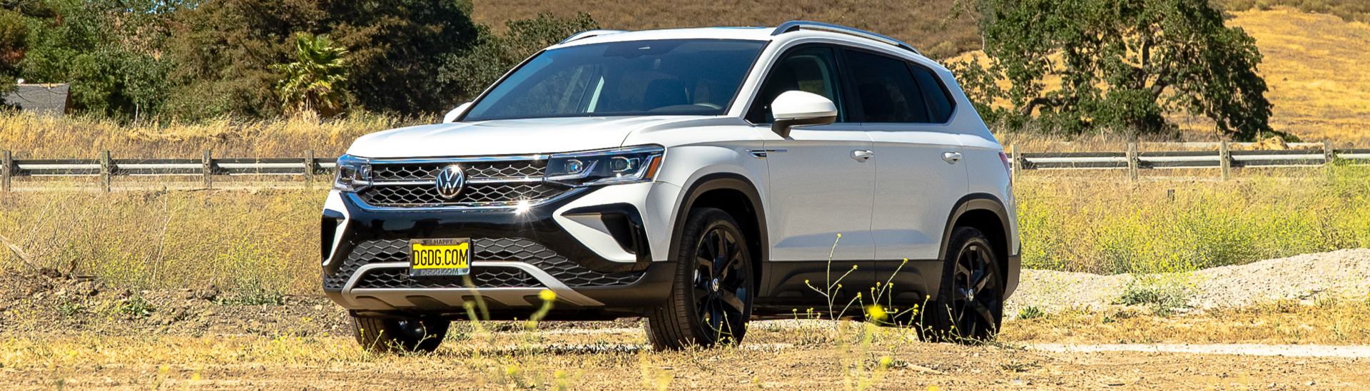 2022 Volkswagen Taos SEL in the color Pure white parked in a grass field.