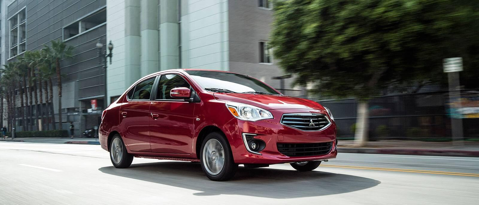 2017 Mitsubishi Mirage in red, driving through the ciyt