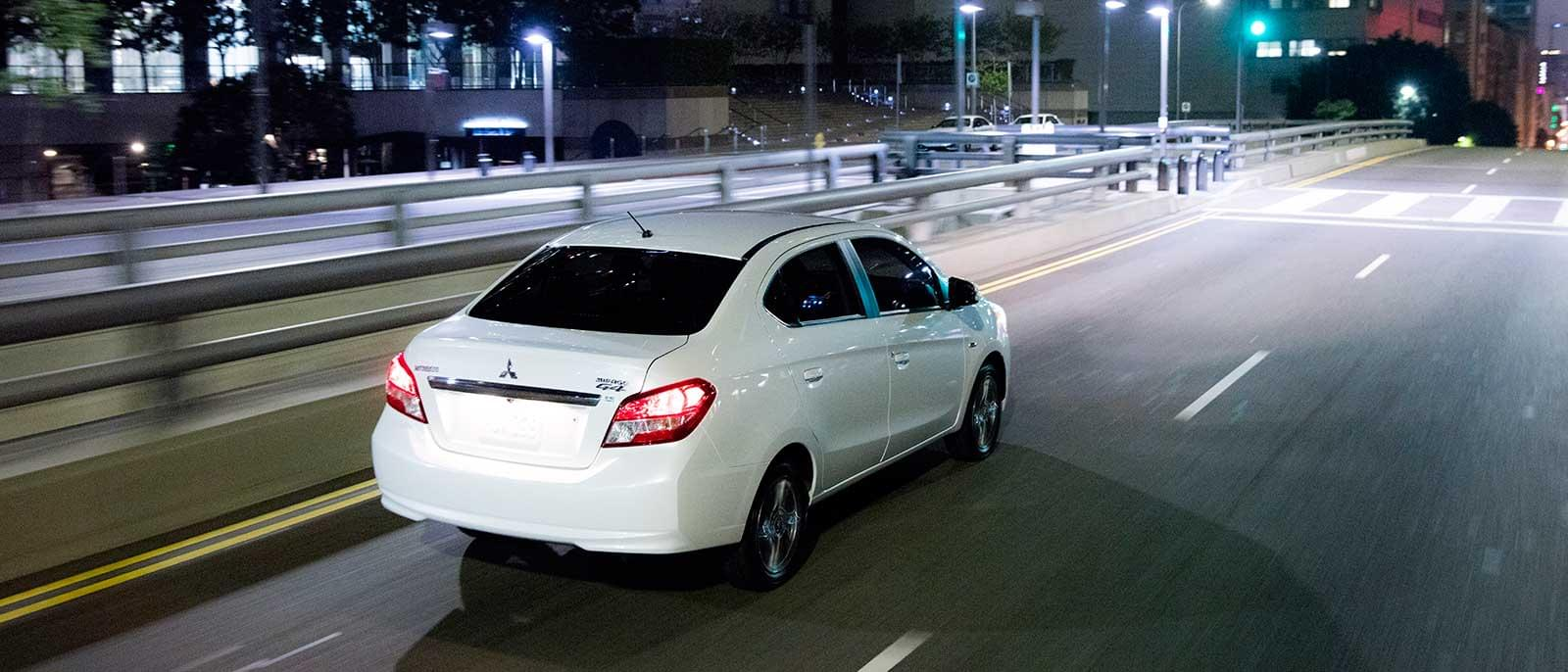 2017 Mitsubishi Mirage in white; rear view night driving