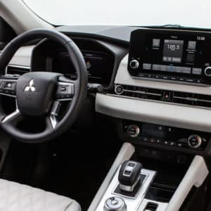 Mitsubishi Outlander interior and driver convenience, including wireless charging and Mitsubishi Connect