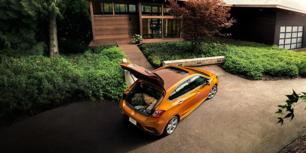 Orange Chevy Cruze in Driveway with trunk open