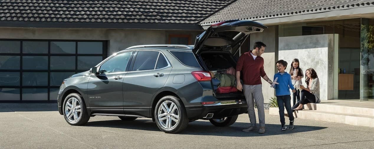 family sit around 2019 Chevrolet Equinox