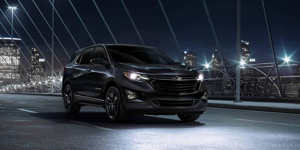 Black 2020 Chevy Equinox driving at night