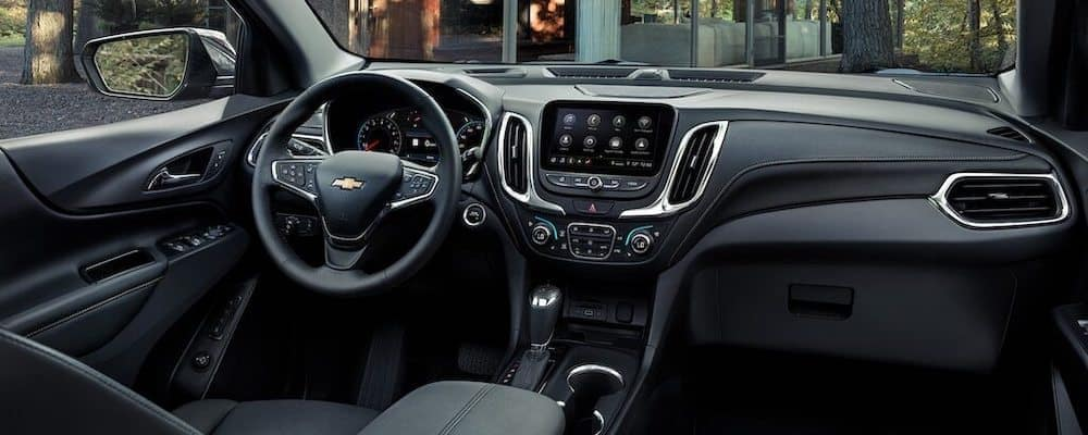 Front seats of 2020 Chevy Equinox interior with wheel and MyLink console
