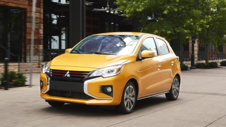 2021 Mitsubishi Mirage Yellow Exterior Parked By Buildings in Chicago