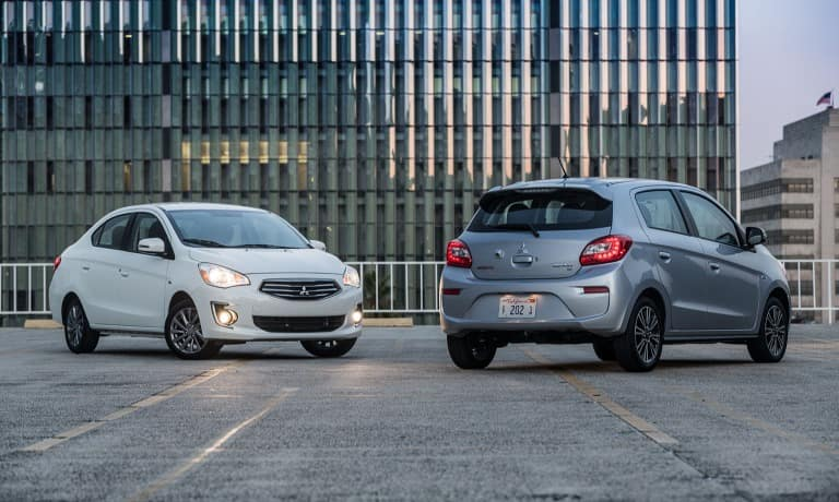 Mitsubishi Mirage G4 parked next side by side