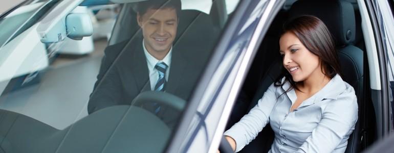 Woman looking at a car 13432825