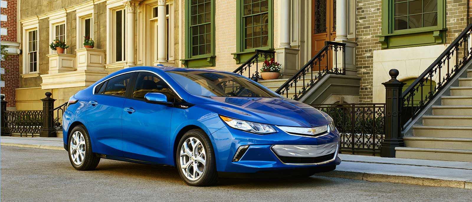 2017 Chevrolet Volt in front of townhouses
