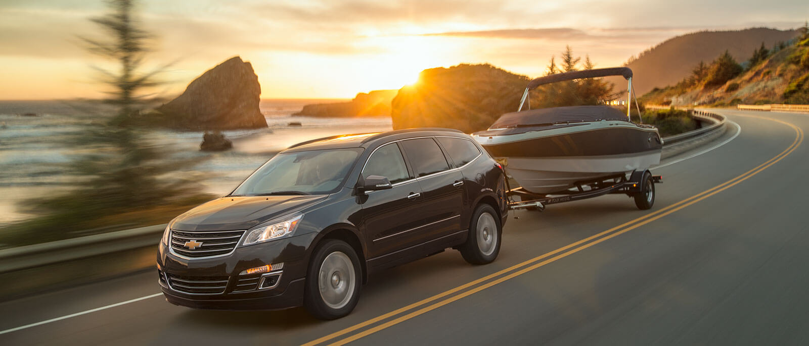 2017 Chevrolet Traverse driving the seaway at dusk