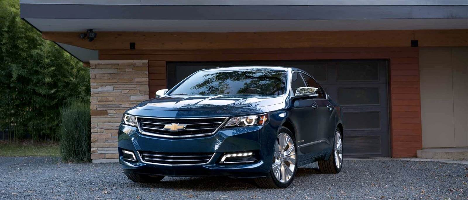 2017 Chevrolet Impala in blue in the driveway