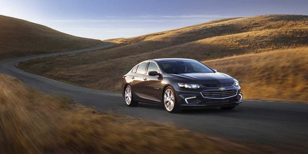 2017 Chevrolet Malibu Driving Down Winding Road