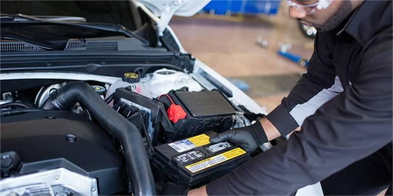 Chevy Mechanic Changing a Battery
