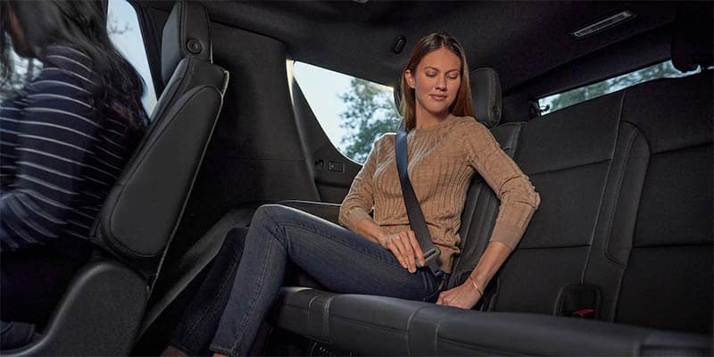 Woman buckling in a Chevy Tahoe