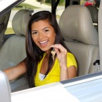 Teen holding up keys to her new car