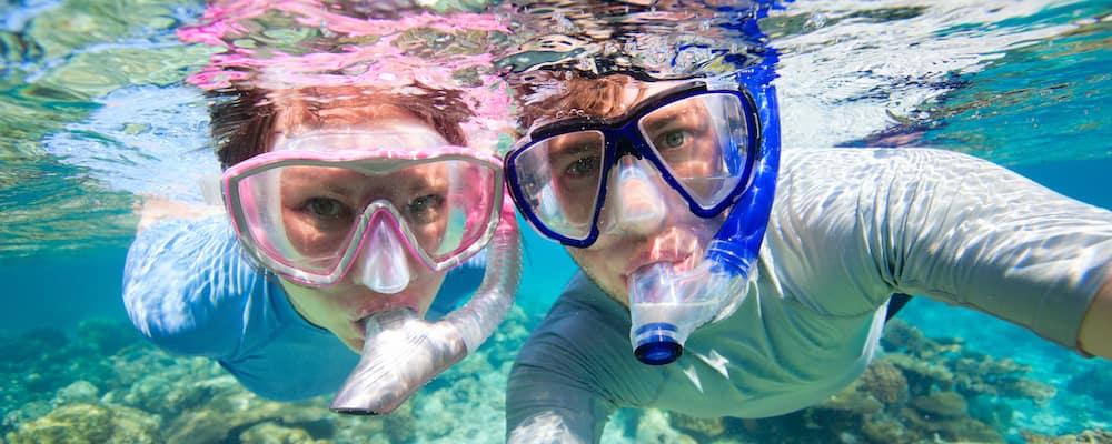 couple snorkeling underwater