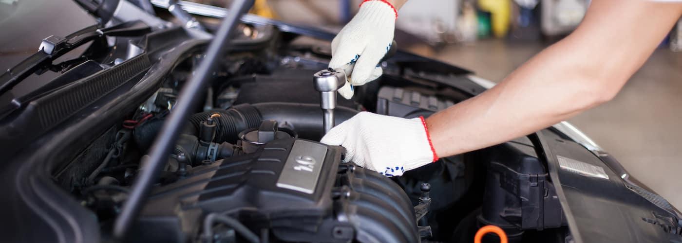 hands of mechanic under hood