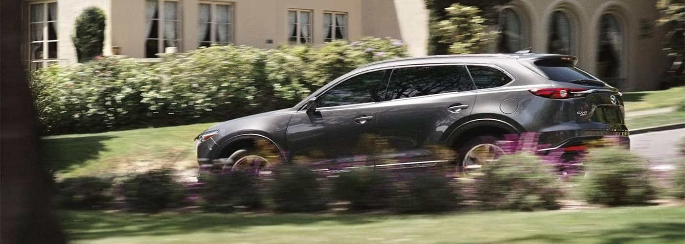 Mazda CX-9 Driving Through A Neighborhood