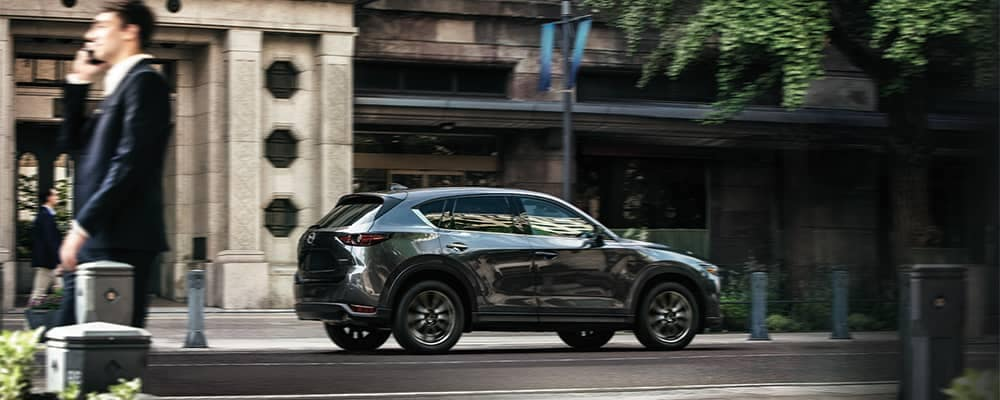 Mazda CX-5 Driving Down Street Through Town