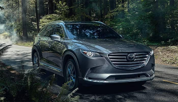 Mazda CX-9 Driving Through the Woods