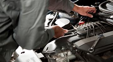 Mechanic's hands under hood