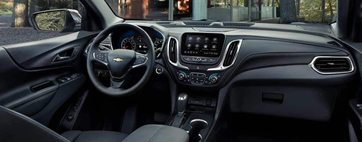 The black interior front seats are shown in a 2021 Chevy Equinox.