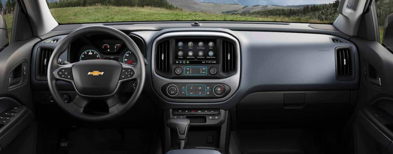 The black interior and front dashboard are shown in a 2021 Chevy Colorado.