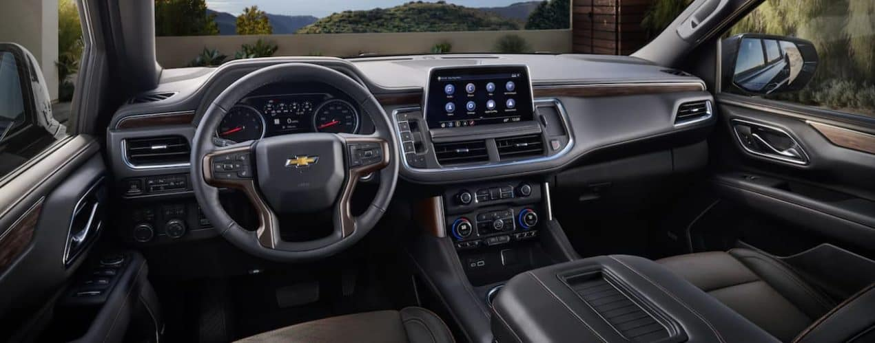 The dashboard and infotainment screen are shown in a 2021 Chevy Suburban.