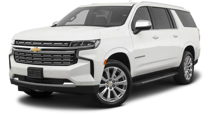 A white 2021 Chevy Suburban is angled left.