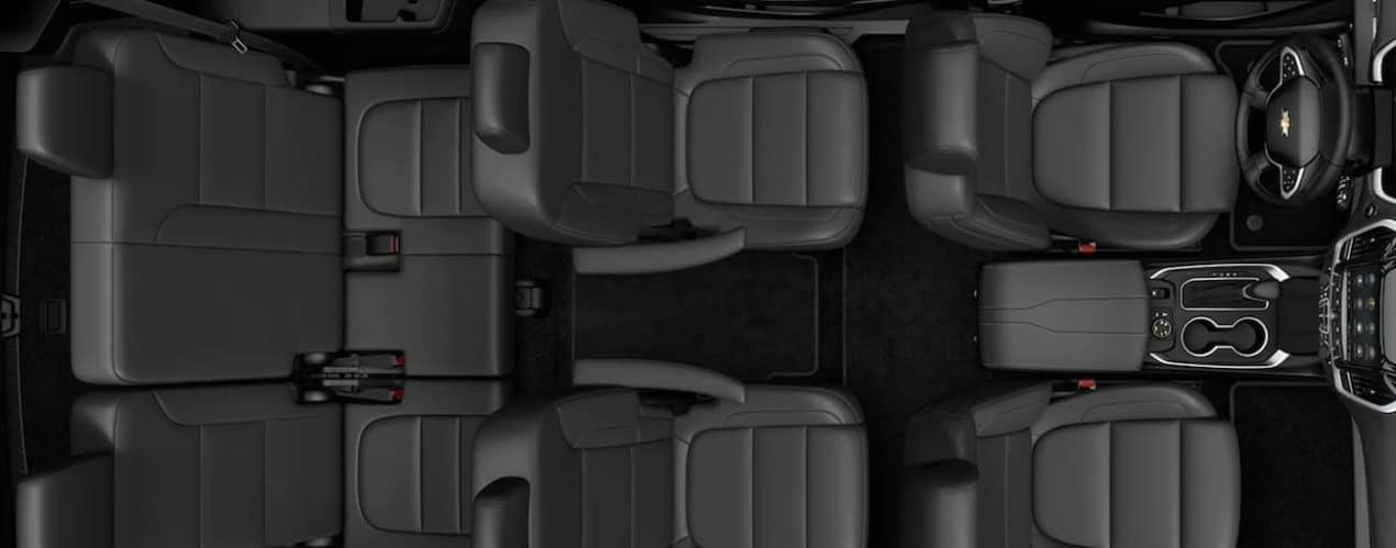 The black interior of a 2021 Chevy Traverse is shown.