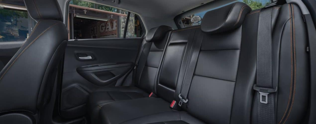 A close up shows the rear black leather seats in a 2021 Chevy Trax.