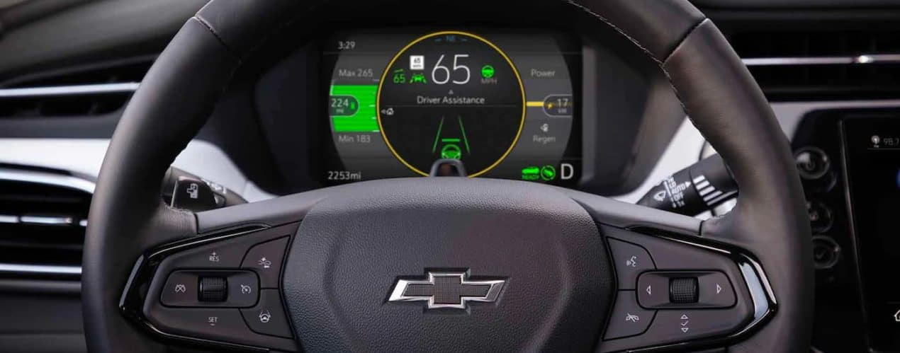A close up shows the steering wheel and driver assist features in a 2022 Chevy Bolt EUV.