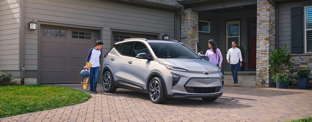 A silver 2022 Chevy Bolt EUV is shown parked in a driveway.