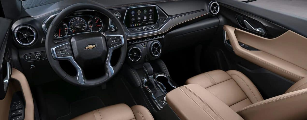 The interior of a 2022 Chevy Blazer shows the steering wheel and infotainment screen.