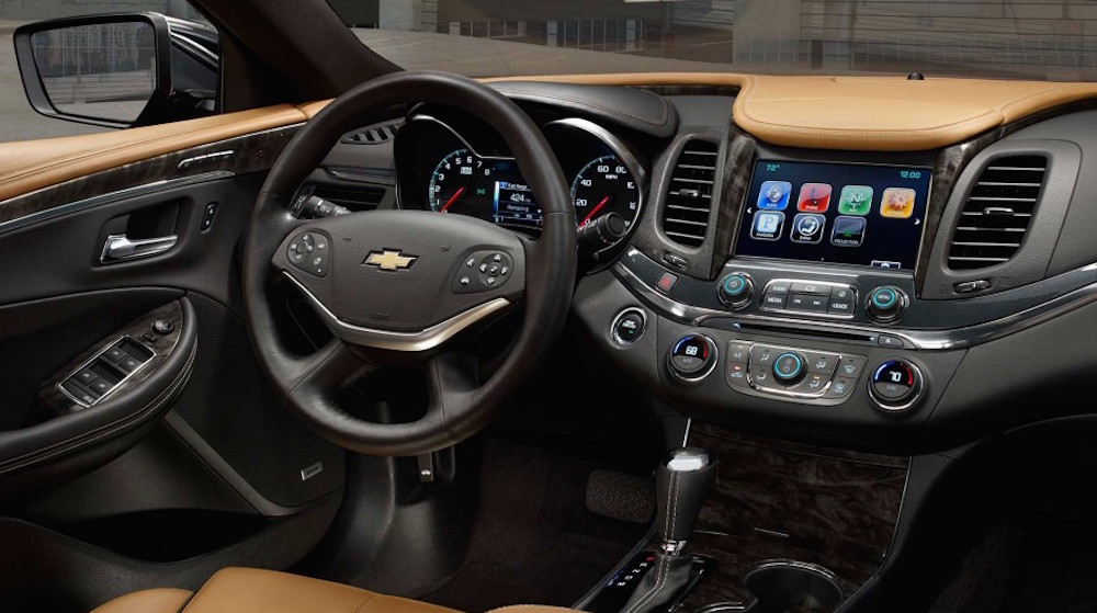 The black and tan dashboard of a 2016 Chevy Impala is shown.