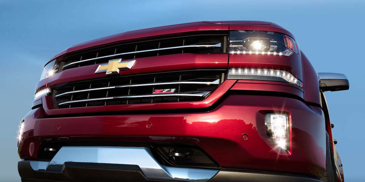 A closeup of a red 2016 Chevy Silverado grille with Z71 badging