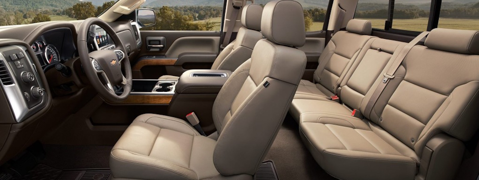 The tan interior of a 2016 Chevy Silverado is shown from the side.
